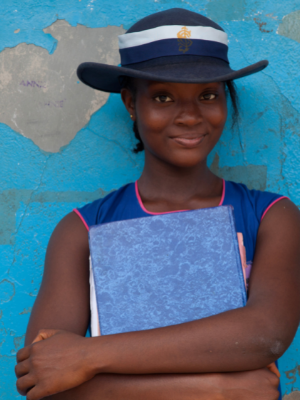 girl holding book. blue background
