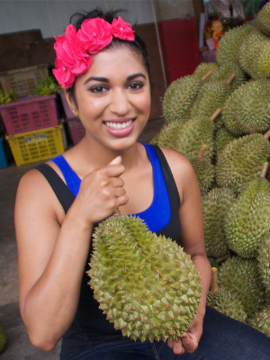 woman holding durian fruit